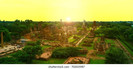 "Aerial shot of Sunset at "" WAT MAHATHAT AYUTTHAYA "" , Thailand   A UNESCO world heritage ancient Buddhist temple ruin in Ayutthaya province , Thailand"
