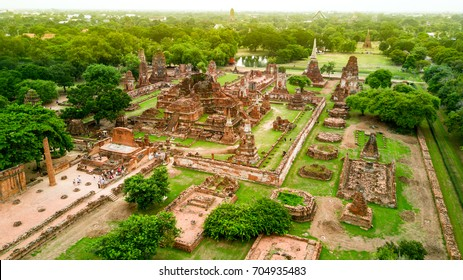 """Aerial shot of Sunset at """" WAT MAHATHAT AYUTTHAYA """" , Thailand   A UNESCO world heritage ancient Buddhist temple ruin in Ayutthaya province , Thailand"""