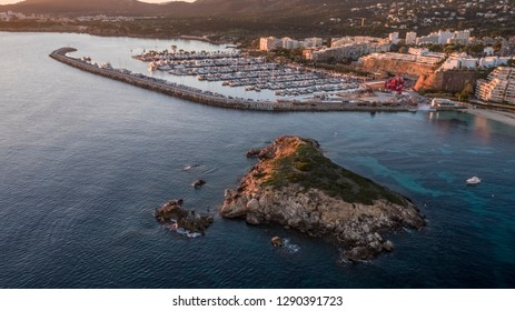 Aerial shot at sunset of the yacht marina of Puerto Portals, Mallorca. A popular European holiday destination
