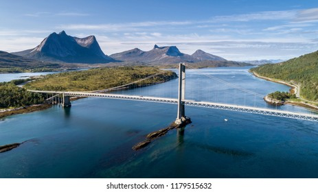 Aerial shot of a suspension bridge over Efjord with  mountain Stortinden in the background, Ballangen, Norway