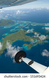 Aerial shot of tropical islands from light aircraft