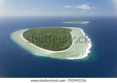 Aerial shot of two tropical islands of Sonsorrol, Palau