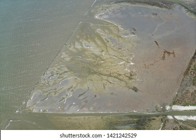 Aerial shot of Unesco World Heritage site in the Waddensea, Holland. The difference between high tide and low tide gives the mud bottom of the ocean an abstract view
