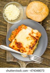 aerial shot of vegetable lasagna baked portion on wooden