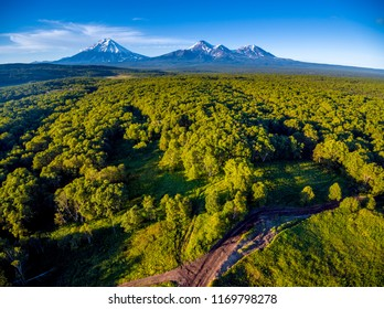 Aerial shot of volcanoes panorama at golden hour