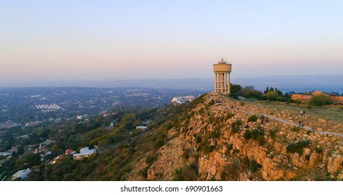 An aerial shot of the water tower atop the Northcliff Hill in Johannesburg, South Africa, taken at sunset.