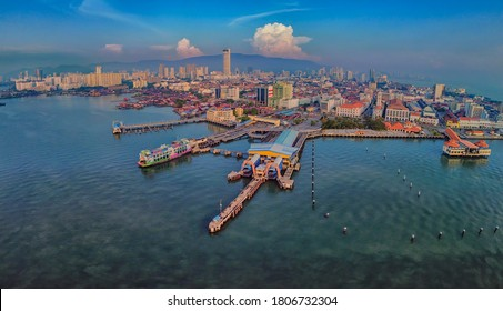 Aerial shot at Weld Quay in Penang during sunrise. Soft focus effect due to large aperture setting and distortion effect due to panoramic stacking