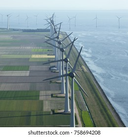 Aerial shot of windfarm Westermeerwind in the Dutch Noordoostpolder, Flevoland and the IJsselmeer, near the town of Urk.