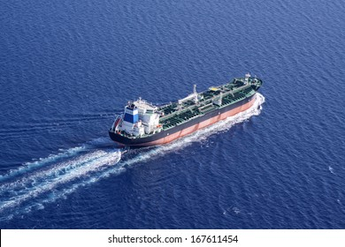 Aerial side view of oil tanker ship on open sea