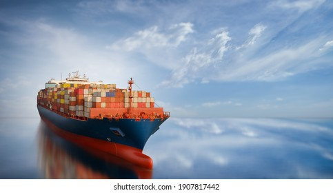 Aerial side view of smart cargo ship carrying container from custom container depot go to ocean concept freight shipping by ship service on blue sky background. - Shutterstock ID 1907817442