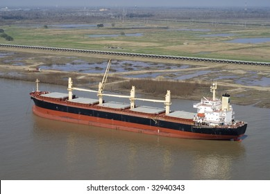 Aerial of single cargo ship at anchor in Mississippi River