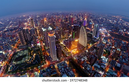 Aerial skyline of Downtown Taichung, the vibrant metropolis in central Taiwan, with modern skyscrapers towering in the 7th Redevelopment Zone and the city lights dazzling at blue dusk after sunset