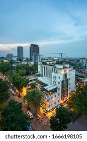 Aerial skyline view of Hanoi city, Vietnam. Hanoi cityscape by sunset period at August Revolution Square, with Hanoi Opera House - Shutterstock ID 1666198105
