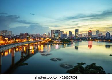 Aerial skyline view of Hanoi. Hanoi cityscape at twilight at Hoang Cau lake