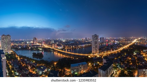 Aerial skyline view of Hanoi at Linh Dam lake, Belt Road No. 3. Hanoi cityscape by sunset period