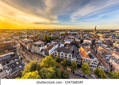 Aerial Skyline view of historic Groningen city centre under setting sun. The Netherlands