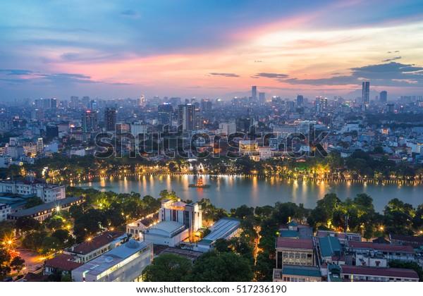 Aerial skyline view of Hoan Kiem lake (Ho Guom, Sword lake) area at twilight. Hoan Kiem is center of Hanoi city. Hanoi cityscape.