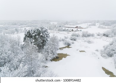 Aerial: Snow-covered countryside in winter