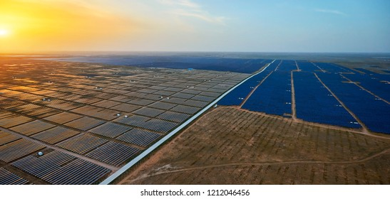 Aerial solar photovoltaic panels and loess at sunset