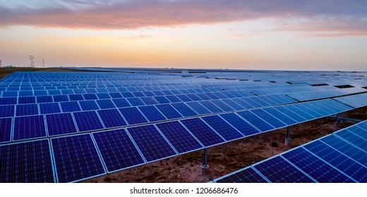 Aerial solar photovoltaic panels in the sunset, outdoors