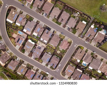 Aerial straight down view of streets and houses, many with solar panels in Folsom, California.