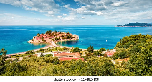 Aerial summer cityscape of Sveti Stefan town. Panoramic morning seascape of Adriatic sea, Montenegro, Europe. Beautiful world of Mediterranean countries. Traveling concept background.