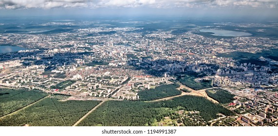 Aerial summer panoramic detailed landscape skyline overview of ural city Yekaterinburg in ural region russia with town road residential block forest park lake beautiful urban landmark air travel view