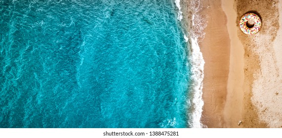 Aerial summer photo of ocean with waves and yellow beach . Free space for your decoration.