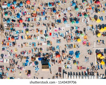 Aerial Summer View Of Crowded Beach Full Of People