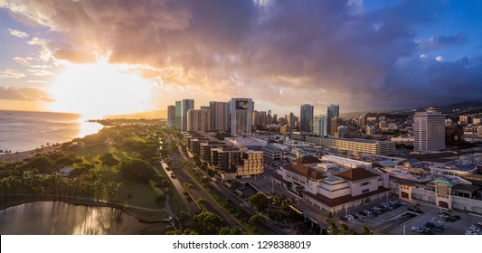 Aerial of sun setting over downtown Honolulu