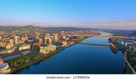 Aerial sunrise of the Fremont Bridge and the waterfront in downtown Portland Oregon on a sunny summer day