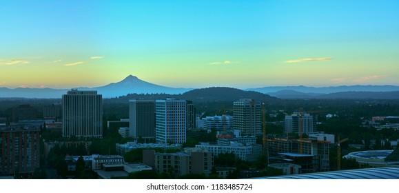 Aerial sunrise of Mt Hood overlooking downtown Portland facing West