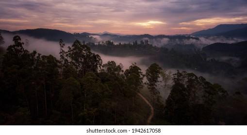 Aerial sunrise over a misty mountain range. Foggy landscape at dawn in Sri Lanka, Srilanka mountains