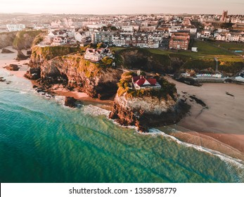 An aerial sunrise view of Newquay beach and town in Cornwall, England.