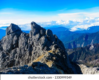 The aerial sunrise view from the top of Carstensz Pyramid (Mt. Puncak Jaya) in Papua island in Indonesia.