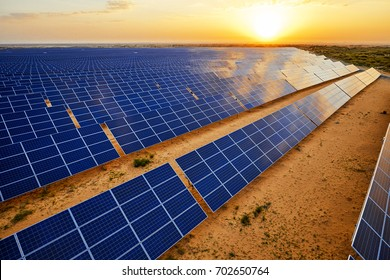 Aerial sunrise when the desert solar photovoltaic