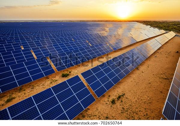 Aerial sunrise when the desert solar photovoltaic