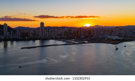 Aerial: Sunset at the city (Itajai, Brazil)