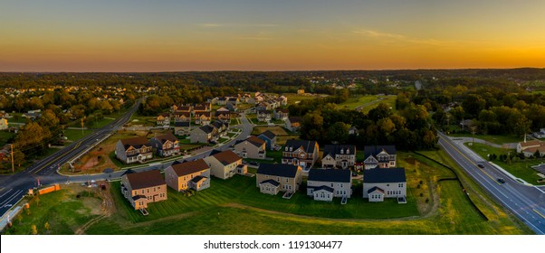 Aerial sunset landscape of typical American new construction neighborhood in Maryland for the upper middle class, single family homes