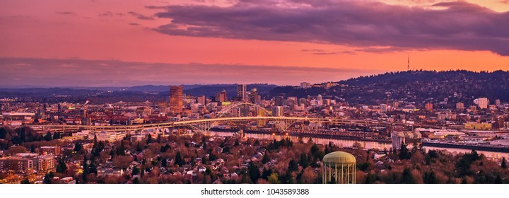 Aerial sunset over downtown Portland Oregon showing the waterfront, the Fremont Bridge,  Broadway Bridge, and US Bank Corp Tower on a cold Winters evening showing