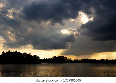 Aerial sunset or sunrise sky over a lake framed with scattered clouds varying in color