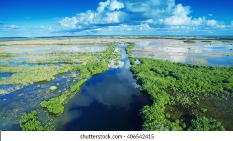 Aerial sunset view of Everglades swamp in Florida.