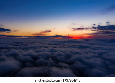 Aerial sunset view over the Blue Ridge Mountains from the cockpit of a private aircraft. Sky with clouds. Sky background