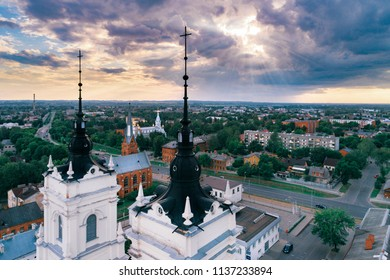 Aerial sunset view over church rooftops in city Daugavpils, Latvia.