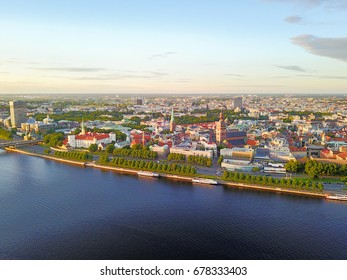 Aerial sunset view of the river Daugava and Riga old town from above.
