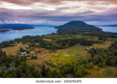 Aerial Sunset View of Rural Lummi Island, Washington. Lummi Island is located in the Salish Sea area of the Pacific Northwest and Washington state.