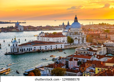 Aerial sunset view of Venice, Grand Canal and Basilica di Santa Maria della Salute in Venice, Italy. Architecture and landmarks of Venice. Venice postcard