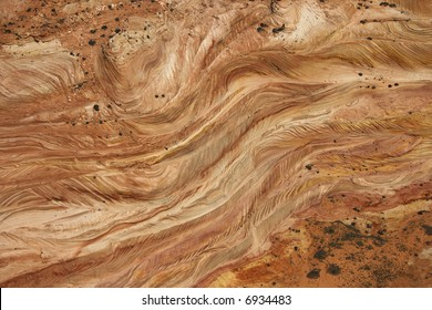 Aerial of textured red rock in desert of Arizona, USA.