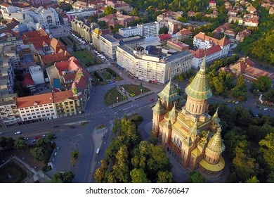 Aerial of Timisoara, Romania featuring the Metropolitan Cathedral and the Victory Square (Piata Victoriei).