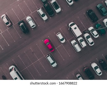 Aerial top down drone shot of city parking.